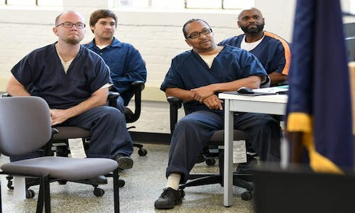 Inmates of the Parnell Correction Facility listen to Google employee discuss imposter syndrome.